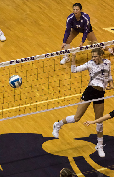 Junior middle blocker, Elle Sandbothe blocks the ball during the first match against Oregon State at Ahern Fieldhouse on Sept. 7 2018. ( Sabrina Cline | Collegian Media Group )