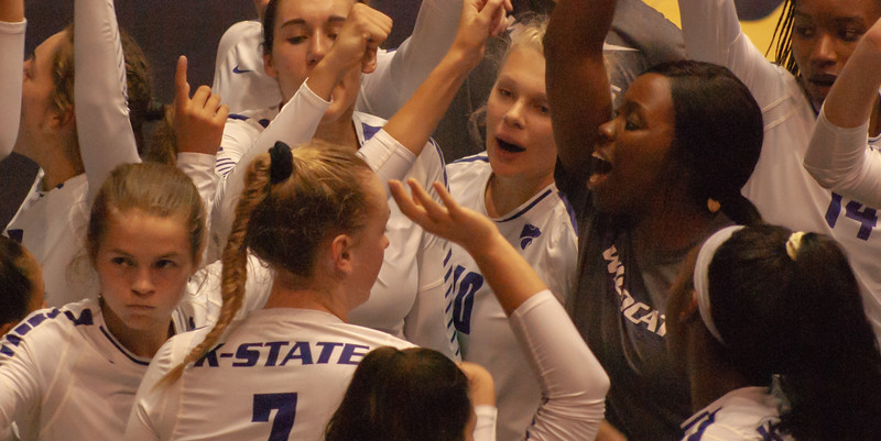 Breaking a huddle the Kansas State Wild Cats go into the third set ready to take on the Oregon State Beavers in their home stadium Ahearn Fieldhouse (Rowan Jones | Collegian Media Group)r