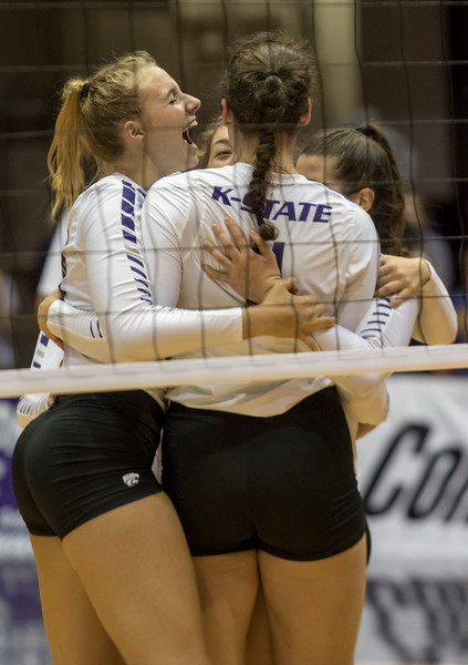 Middle blocker Zsofia Gyimes celebrates with her teammates after winning the final point during the final match against Oregon State at Ahern Fieldhouse on Sept. 7 2018. ( Sabrina Cline | Collegian Media Group