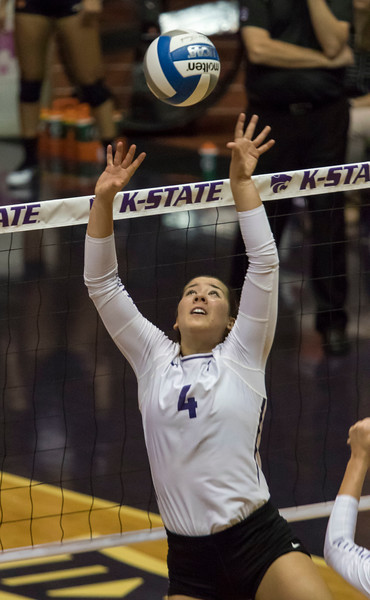 Setter, Sarah Dixon sets the ball up for her teammate against Oregon State at Ahern Fieldhouse on Sept. 7 2018. ( Sabrina Cline   Collegian Media Group )