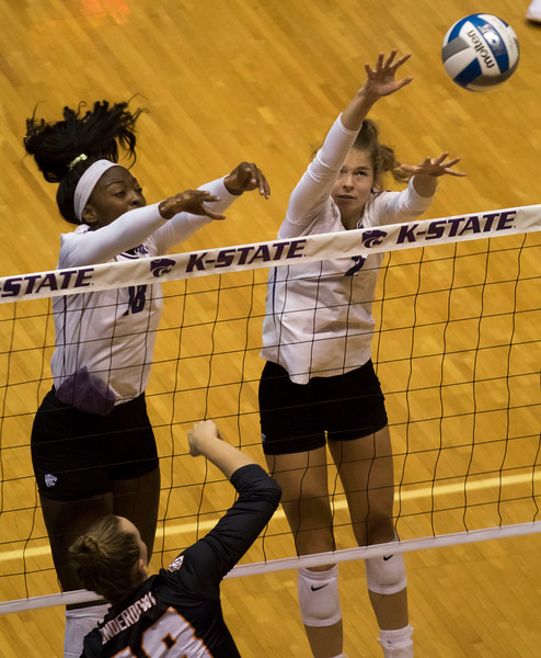 Freshman opposite, Gloria Mutiri and Junior middle blocker, Elle Sandbothe block the ball during the first match against Oregon State at Ahern Fieldhouse on Sept. 7 2018. ( Sabrina Cline | Collegian Media Group )