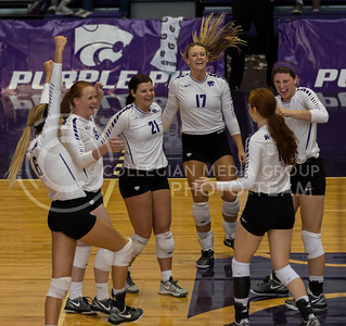 The K-State volleyball team celebrates a point during the match against TCU in Ahearn Field House on Oct. 8, 2016. (Nathan Jones | The Collegian)