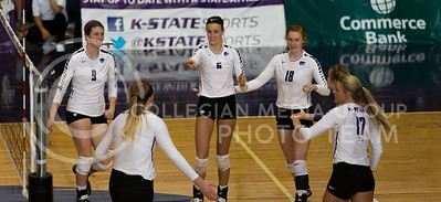 The K-State volleyball team celebrates a point over during the volleyball match against TCU in Ahearn Field House on Oct. 8, 2016. (Nathan Jones | The Collegian)