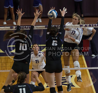 Senior outside hitter Brooke Sassin hits the ball over the net past the blockers during the K-State volleyball match against TCU in Ahearn Field House on Oct. 8, 2016. (Nathan Jones | The Collegian)