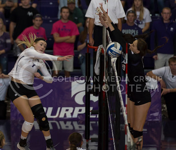 Sophomore outside hitter Kylee Zumach spikes the ball over the net during the K-State volleyball match against TCU in Ahearn Field House on Oct. 8, 2016. (Nathan Jones | The Collegian)