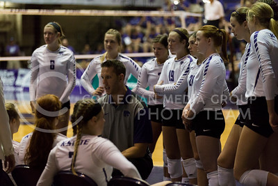 Assistant coach Trent Sorensen talks to the team between sets during the volleyball match against West Virginia in Ahearn Field House on Oct. 22, 2016. (Nathan Jones | The Collegian)