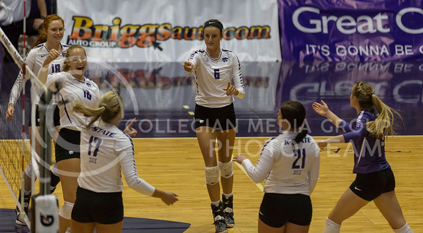 The K-State volleyball team celebrates a point during the volleyball match against West Virginia in Ahearn Field House on Oct. 22, 2016. (Nathan Jones | The Collegian)