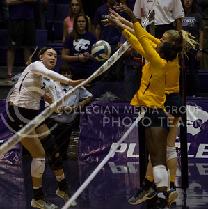 Sophomore outside hitter Kylee Zumach spikes the ball over the net during the K-State volleyball match against West Virginia in Ahearn Field House on Oct. 22, 2016. (Nathan Jones | The Collegian)