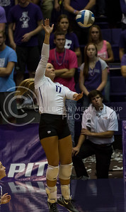 Senior outside hitter Brooke Sassin jumps to hit the ball during the K-State volleyball match against West Virginia in Ahearn Field House on Oct. 22, 2016. (Nathan Jones | The Collegian)