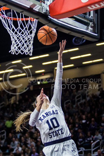 Junior guard, Kayla Goth, charges the basket against KU in Bramlage Coliseum on Feb. 24, 2018. The Wildcats defeated the Jayhawks 91-67. (Logan Wassall | Collegian Media Group)
