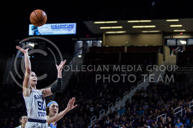 Senior guard, Shaelyn Martin, charges the basket on a fast break against KU in Bramlage Coliseum on Feb. 24, 2018. The Wildcats defeated the Jayhawks 91-67. (Logan Wassall | Collegian Media Group)