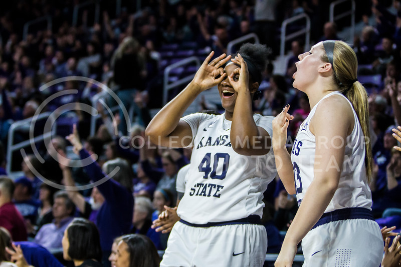The K-State women's basketball team celebrates together during their game against KU in Bramlage Coliseum on Feb. 24, 2018. The Wildcats defeated the Jayhawks 91-67. (Logan Wassall | Collegian Media Group)