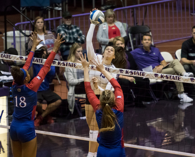 Redshirt freshman outside hitter Holly Bonde spikes the ball during the game against the University of Kansas on Oct. 23, 2019 in Ahern Fieldhouse. (Sabrina Cline | Collegian Media Group)