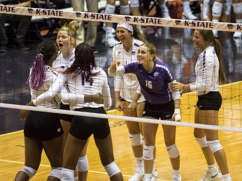 The volleyball team celebrates after a kill during the game against the University of Kansas on Oct. 23, 2019 in Ahern Fieldhouse. (Sabrina Cline | Collegian Media Group)