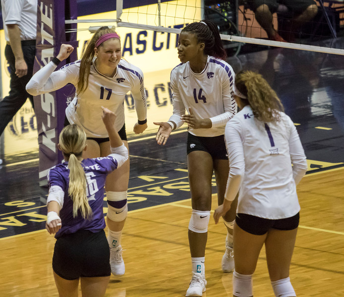 Redshirt sophomore outside hitter Brynn Carlson screams with her teammates in celebration after a kill during the game against the University of Kansas on Oct. 23, 2019 in Ahern Fieldhouse. (Sabrina Cline | Collegian Media Group)