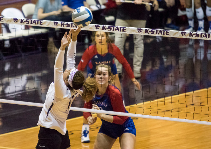 Freshman setter Teana Adams-Kaonohi sets the ball during the game against the University of Kansas on Oct. 23, 2019 in Ahern Fieldhouse. (Sabrina Cline | Collegian Media Group)