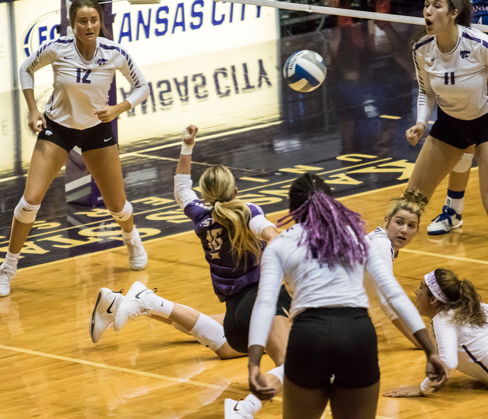 Freshman libero Dru Kuck digs the ball during the game against the University of Kansas on Oct. 23, 2019 in Ahern Fieldhouse. (Sabrina Cline | Collegian Media Group)