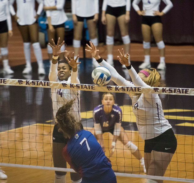 Redshirt sophomore outside hitter Brynn Carlson and teammate redshirt sophomore middle blocker Megan Vernon block the ball during the game against the University of Kansas on Oct. 23, 2019 in Ahern Fieldhouse. (Sabrina Cline | Collegian Media Group)