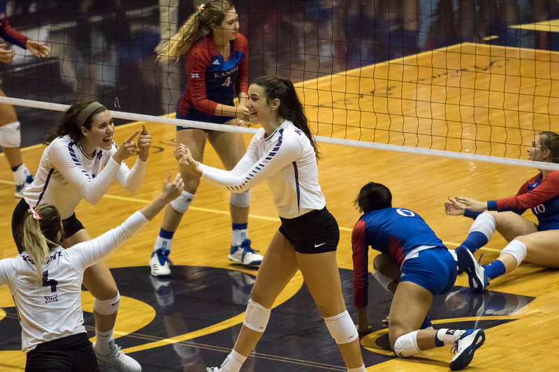 Redshirt freshman outside hitter Holly Bonde celebrates with her teammates after a kill during the game against the University of Kansas on Oct. 23, 2019 in Ahern Fieldhouse. (Sabrina Cline | Collegian Media Group)