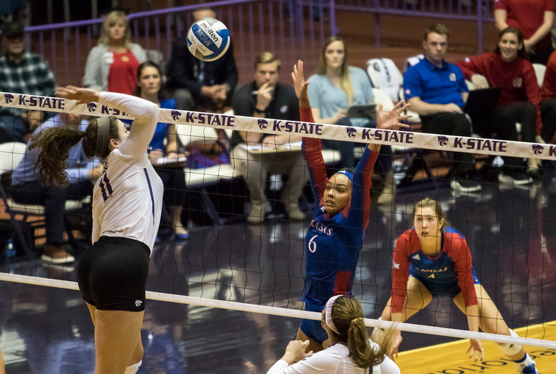 Redshirt junior middle blocker Peyton Williams spikes the ball during the game against the University of Kansas on Oct. 23, 2019 in Ahern Fieldhouse. (Sabrina Cline | Collegian Media Group)