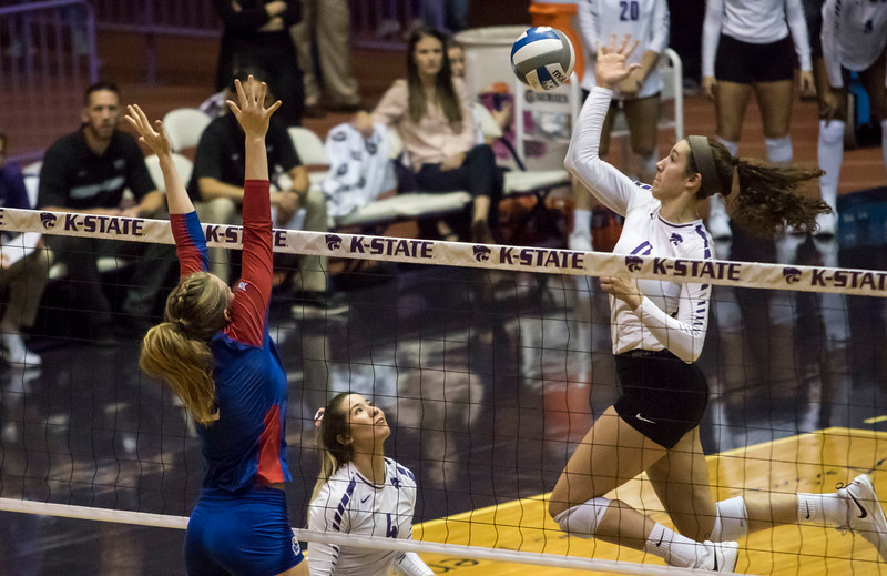 Redshirt junior middle blocker Peyton Williams tips the ball during the game against the University of Kansas on Oct. 23, 2019 in Ahern Fieldhouse. (Sabrina Cline | Collegian Media Group)