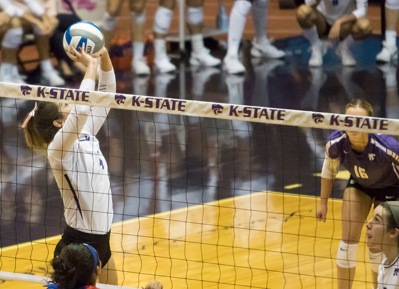 Redshirt senior setter Sarah Dixon sets the ball during the game against the University of Kansas on Oct. 23, 2019 in Ahern Fieldhouse. (Sabrina Cline | Collegian Media Group)