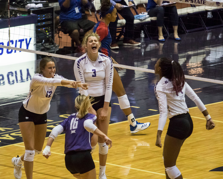 Freshman outside hitter Anna Dixon and teammate freshman defensive specialist Loren Hinkle scream in celebration after a kill during the game against the University of Kansas on Oct. 23, 2019 in Ahern Fieldhouse. (Sabrina Cline | Collegian Media Group)