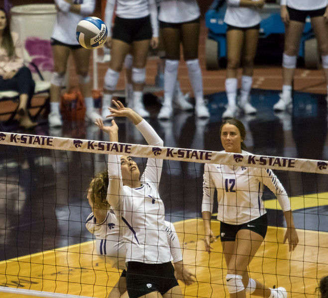 Freshman setter Teana Adams-Kaonohi sets the ball to redshirt junior  during the game against the University of Kansas on Oct. 23, 2019 in Ahern Fieldhouse. (Sabrina Cline | Collegian Media Group)