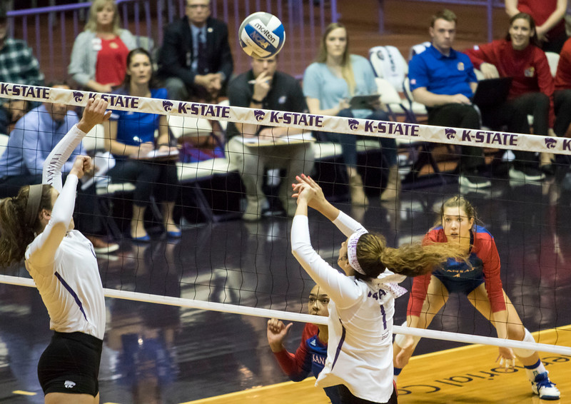 Freshman setter Teana Adams-Kaonohi sets the ball to redshirt junior middle blocker Peyton Williams during the game against the University of Kansas on Oct. 23, 2019 in Ahern Fieldhouse. (Sabrina Cline | Collegian Media Group)