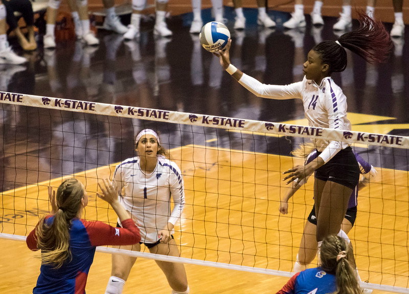 Freshman setter Teana Adams-Kaonohi sets the ball to redshirt sophomore middle blocker Megan Vernon who tips the ball during the game against the University of Kansas on Oct. 23, 2019 in Ahern Fieldhouse. (Sabrina Cline | Collegian Media Group)