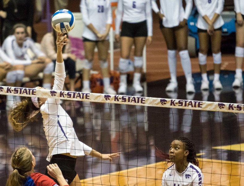 Freshman setter Teana Adams-Kaonohi saves the ball during the game against the University of Kansas on Oct. 23, 2019 in Ahern Fieldhouse. (Sabrina Cline | Collegian Media Group)