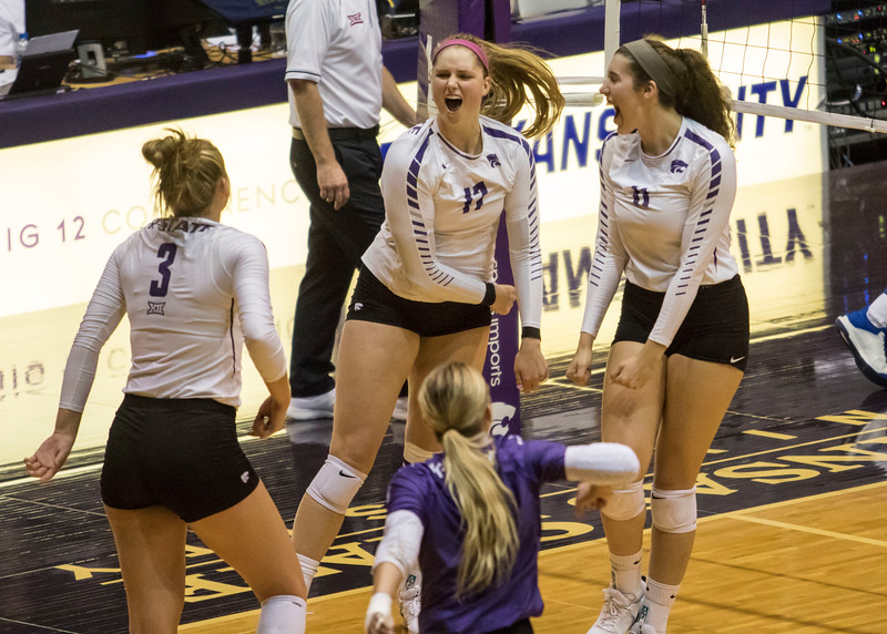 Redshirt sophomore outside hitter Brynn Carlson and teammates celebrate her kill during the game against the University of Kansas on Oct. 23, 2019 in Ahern Fieldhouse. (Sabrina Cline | Collegian Media Group)