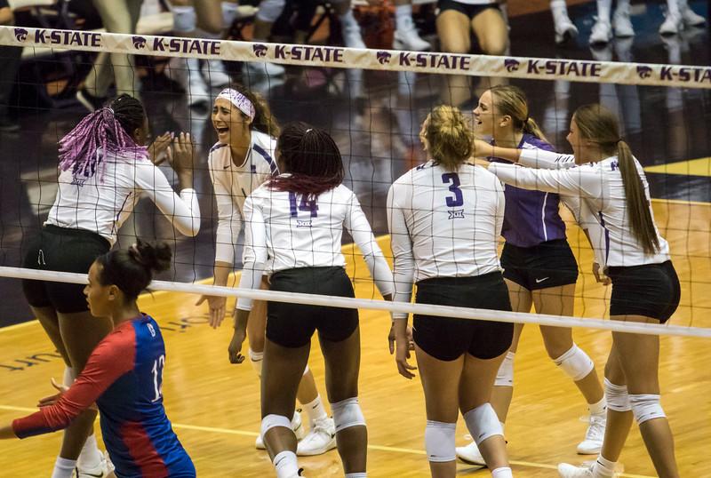 Freshman setter Teana Adams-Kaonohi celebrates her teammates kill during the game against the University of Kansas on Oct. 23, 2019 in Ahern Fieldhouse. (Sabrina Cline | Collegian Media Group)