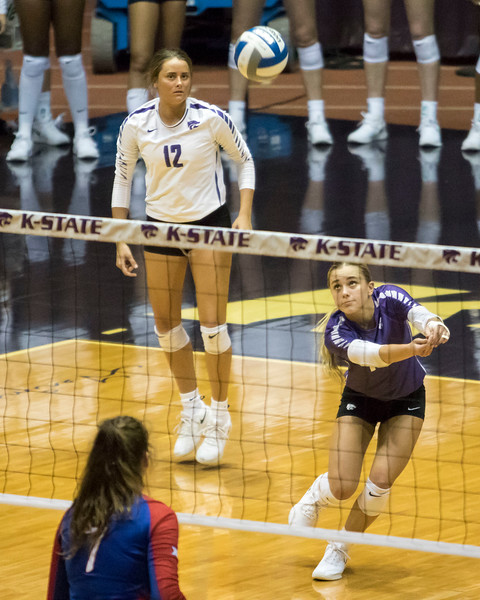 Freshman libero Dru Kuck passes the serve during the game against the University of Kansas on Oct. 23, 2019 in Ahern Fieldhouse. (Sabrina Cline | Collegian Media Group)