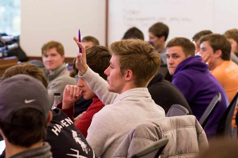 A participant raises his hand to answer a question at a Wildcats Make a Pact session on Oct. 15 in the Business Building. Wildcats Make a Pact is a bystander intervention training that provides participants with the skills to help them intervene safely when they see behavior that puts others at risk for violence, victimization, or perpetration. (Andrea Klepper | Collegian Media Group)