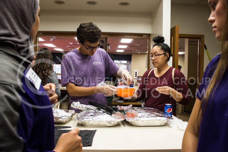 Ricardo Gonzalez, sophomore in geography, helps Susann Yang, senior in anthropology, put together a bowl of Pho at the Wildcats Pho-Ever dinner on Oct. 29, 2017. The event was put on by Wildcats Forever and the Asian American Student Union. (Regan Tokos | Collegian Media Group)
