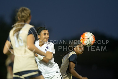 Freshman midfielder Georgia Weigel headbutts the ball during the game between K-State and Oral Roberts on Sept. 23, 2016. (Austin Fuller | The Collegian)