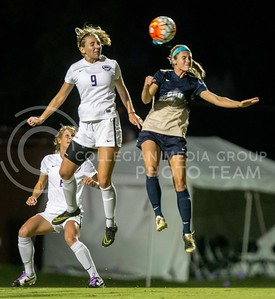 Sophomore defender Megan Kalkofen and Oral Robert's junior forward Kylie Dellis attempt to gain possession while the ball flies through the air. The K-State Woman's Soccer team played Oral Roberts on the newly completed woman's soccer field on Sept. 23, 2016. (Austin Fuller | The Collegian)