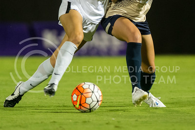 A K-State and an Oral Robert player battle for possession. The K-State Woman's Soccer team played Oral Roberts on the newly completed woman's soccer field on Sept. 23, 2016. (Austin Fuller | The Collegian)