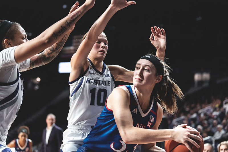 KU guard Kylee Kopatich finds herself in a tough spot, surrounded by K-State guard Kayla Goth and forward Jasauen Beard. The Wildcats lost to the Jayhawks 61-54 in Bramlage Coliseum. (Alex Todd | Collegian Media Group)