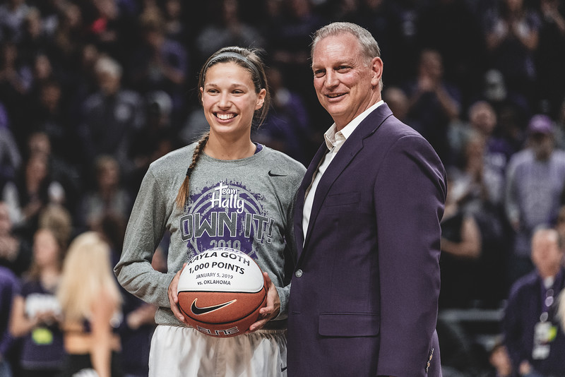 K-State senior Kayla Goth receives a basketball from head coach Jeff Mittie in commemoration of her becoming the 41st player in K-State women's basketball history with 1,000 or more career points. (Alex Todd | Collegian Media Group)