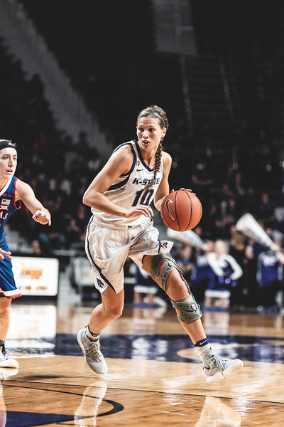 K-State's Kayla Goth flies past the KU defense while determining her next move. K-State lost to KU 61-54 in Bramlage Coliseum on January 13, 2019. (Alex Todd | Collegian Media Group)