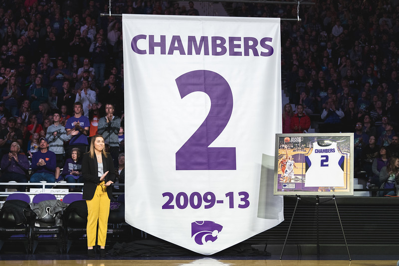 Former All-American guard Brittany Chambers unveils her banner during her jersey retirement ceremony during halftime of the game on Jan. 13, 2019. (Alex Todd | Collegian Media Group)