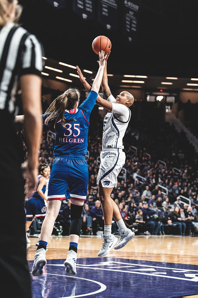 Jumping to evade the KU defense, K-State forward Kali Jones scores two points for the Wildcats. K-State lost to KU 61-54 in Bramlage Coliseum on January 13, 2019. (Alex Todd | Collegian Media Group)