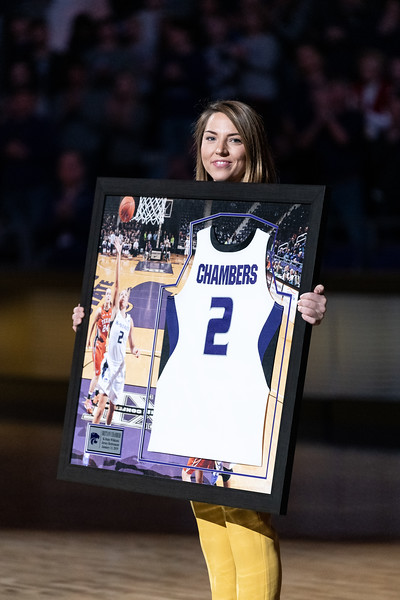 Former All-American guard Brittany Chambers is presented with a framed jersey during her jersey retirement ceremony at the halftime of the game against KU on January 13, 2019. (Alex Todd | Collegian Media Group)