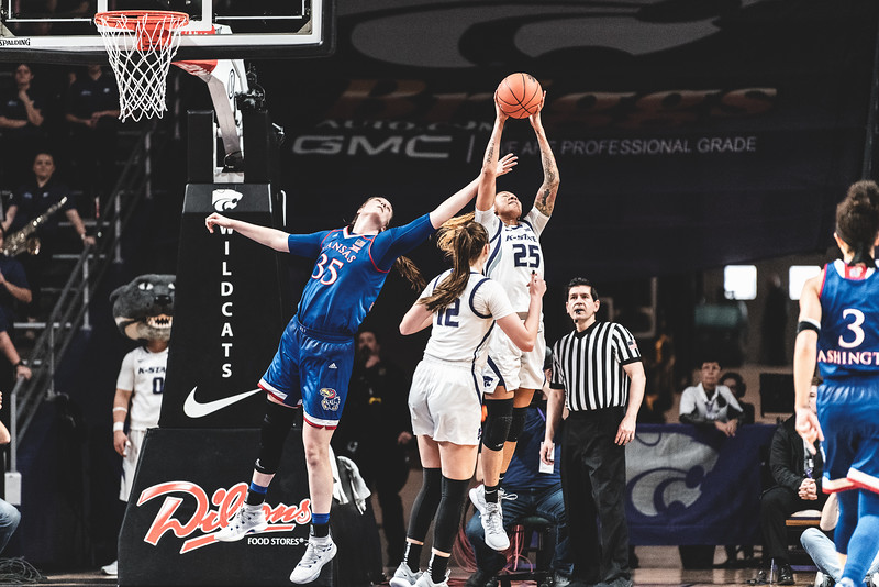 K-State forward Jasauen Beard leaps up to grab a rebound before KU can during the game on January 13, 2019. K-State lost to KU 61-54 in Bramlage Coliseum. (Alex Todd | Collegian Media Group)