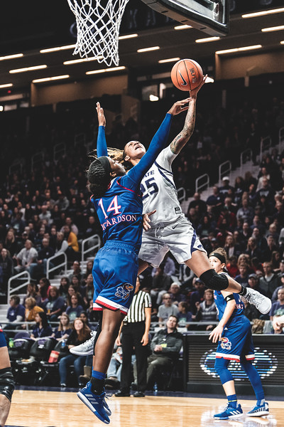 K-State forward Jasauen Beard leaps up to the net in attempt to score two points against KU. The Wildcats lost to the Jayhawks 61-54 in Bramlage Coliseum on January 13, 2019. (Alex Todd | Collegian Media Group)