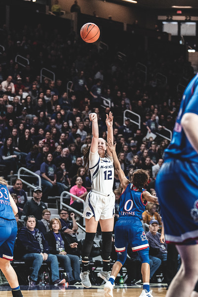 With the KU defense in front of her, K-State's Rachel Ranke shoots and scores three points for the Wildcats. K-State lost to KU 61-54 in Bramlage Coliseum on January 13, 2019. (Alex Todd | Collegian Media Group)