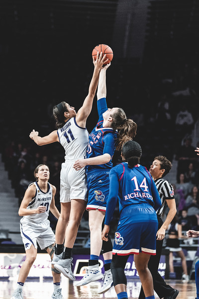 K-State forward Peyton Williams goes up against KU's Bailey Helgren during the tipoff of the game on January 13, 2019. The Wildcats lost to the Jayhawks 61-54 in Bramlage Coliseum. (Alex Todd | Collegian Media Group)