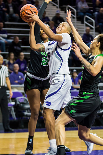 """Senior forward Kali """"KJ"""" Jones jumps up for a shot during K-State's women's basketball game against North Texas in Bramlage Coliseum on Nov. 16, 2018. The Wildcats defeated the Mean Green 60-42. (Logan Wassall 